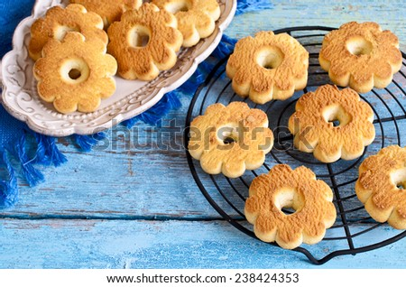 Butter biscuits brown color in the form of a flower on a blue background - stock photo
