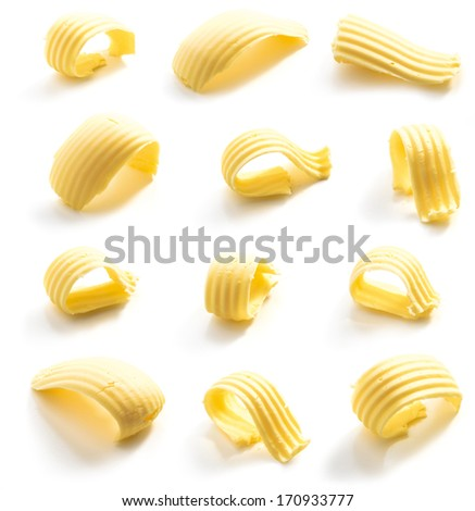 Butter curl isolated on white background. Clipping path included. - stock photo
