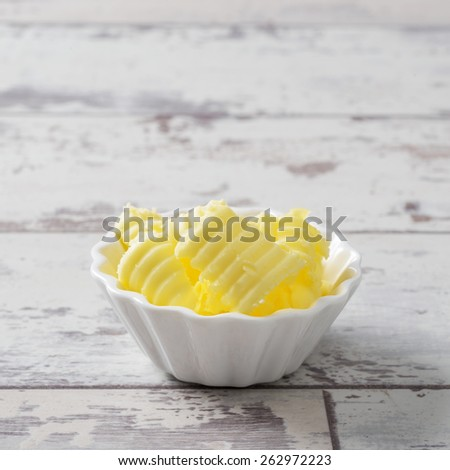 Butter curls in white serving dish - stock photo