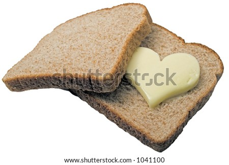 Butter heart melts in between two slices of bread. - stock photo