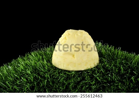 butter on grass - stock photo