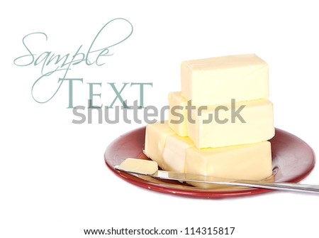 Butter on plate isolated on white - stock photo