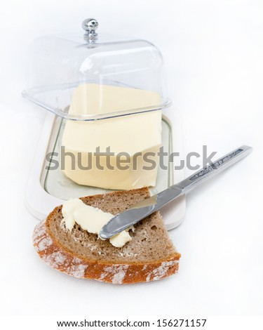 Butter spreading on bread - stock photo