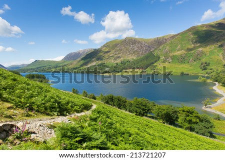 Buttermere uk Lake District Cumbria England beautiful sunny summer day view to High Shockrigg fell  - stock photo