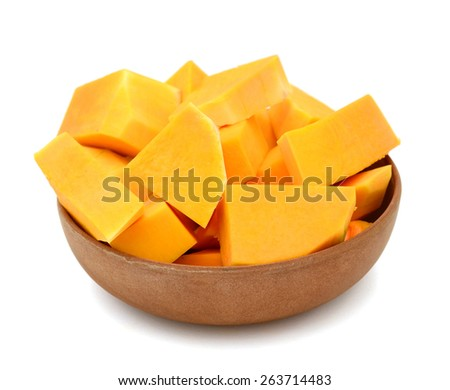 butternut squash cut into chunks in bow on white background  - stock photo
