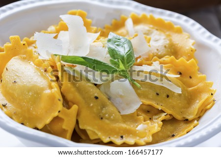 Butternut squash mezzaluna ravioli  in closeup - stock photo