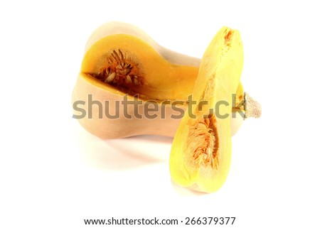 Butternut squash with a quarter on light background - stock photo