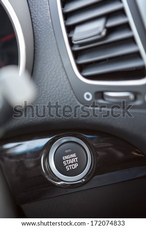Button automatically start the engine car - stock photo