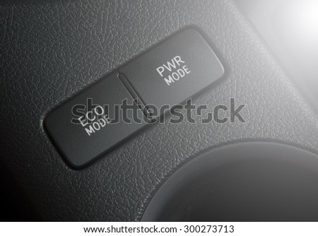 button Eco mode and power mode in car - stock photo