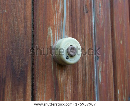 Button on a wooden wall - stock photo
