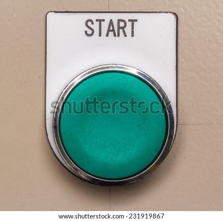 Button to start the machine in a production line. - stock photo