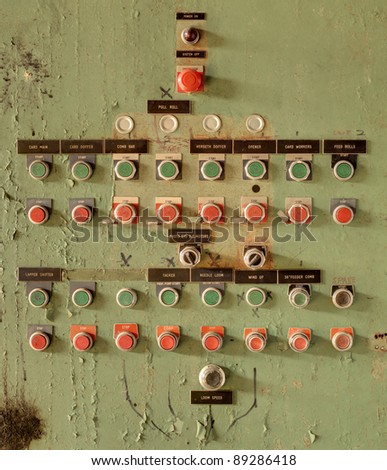 buttons at an old abaonded textile mill - stock photo