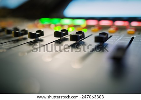 buttons equipment for sound mixer control,selective focus - stock photo