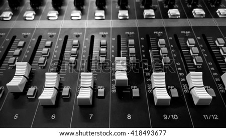 buttons equipment in audio Mixing Console - Black and White - stock photo