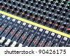 buttons equipment in audio recording studio - stock photo