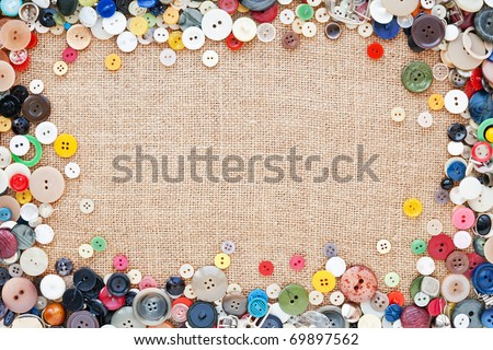 Buttons frame on fabric texture background - stock photo