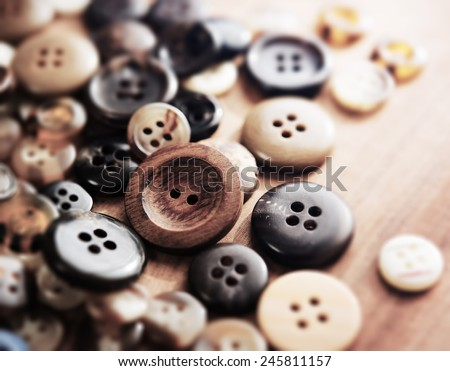Buttons on a old work table. Shallow depth of field. - stock photo