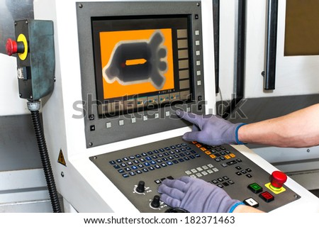 Buttons on computer numerical control machines benchboard. Hand on the control panel of a programmable machine. CNC and milling industry. - stock photo