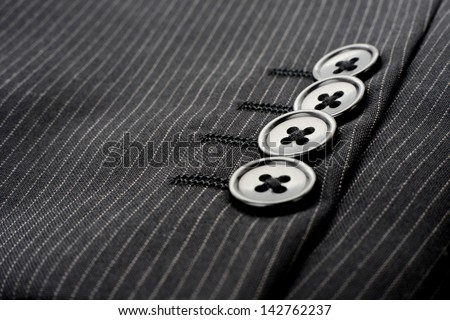 Buttons on sleeve of business suit - stock photo