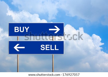 buy and sell on blue road sign with blue sky - stock photo