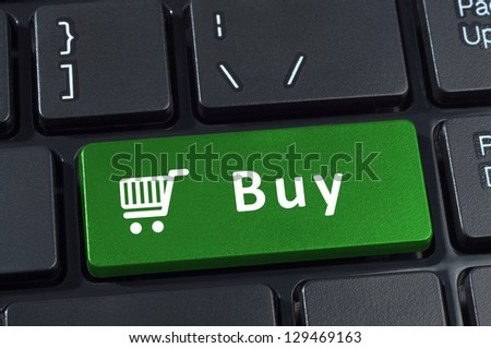 Buy button computer keyboard with trolley icon. Internet concept of consumerism and e-commerce. - stock photo