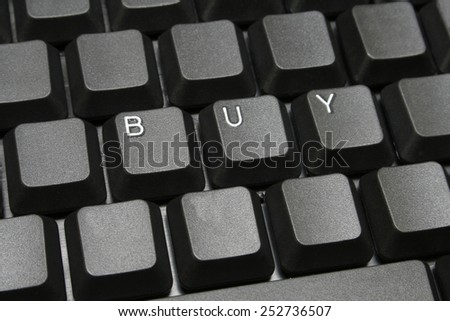 Buy concept on computer keyboard - stock photo