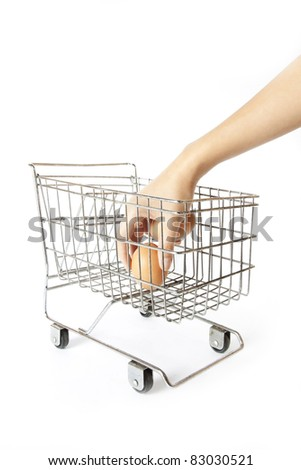 buy egg, female hand put one egg into silver supermarket trolley. - stock photo