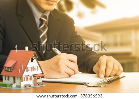 Buy house .Businessman calculate and plan for your good property with real agency property - stock photo