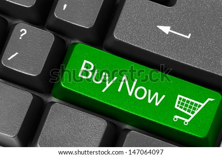 Buy now concepts, with message on computer keyboard. - stock photo