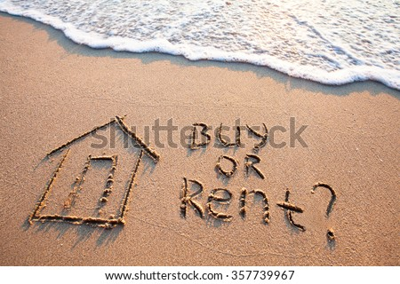 buy or rent concept, text on the sand, real estate - stock photo