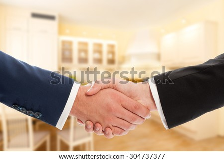 Buy or sale real estate concept with businessmen handshake. Realtor and client or buyer and seller - stock photo