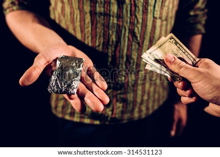 Buying and paying for drugs  - stock photo