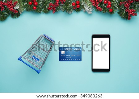 Buying christmas gifts online - online shopping concept. Shopping cart with Christmas gifts and presents. Isolated over white background. - stock photo