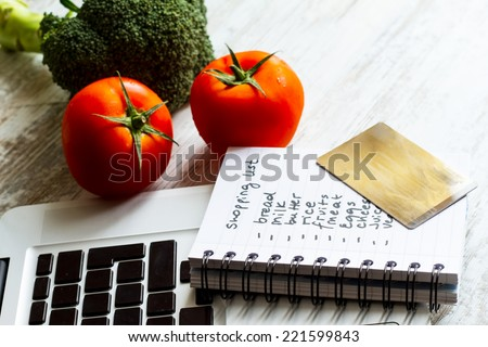 Buying groceries on line with a credit card  - stock photo