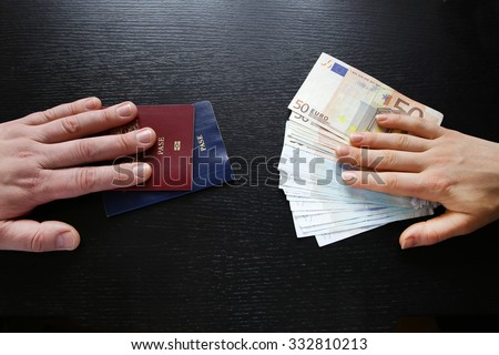 buying illegal foreign passport hands exchanging money and documents buyer seller - stock photo