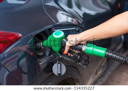 Buying petrol - stock photo
