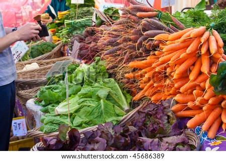 buying produce at farmers market - stock photo