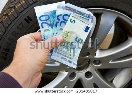 Buying winter tire - stock photo