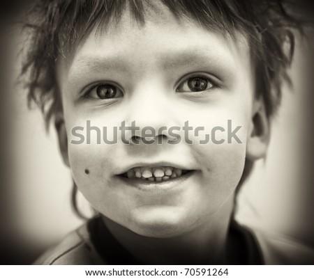 BW portrait of smiling happy boy - stock photo