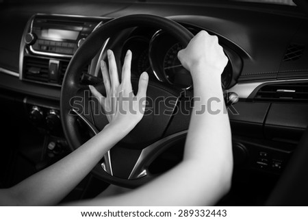 BW tone of Cockpit drive abstract. hand pushing horn - stock photo