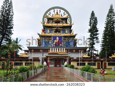 BYLAKUPPE, KARNATAKA, INDIA - OCTOBER 25, 2014: Guru Rinpoche Temple part of the Namdroling Monastery, also known locally as the Golden Temple. - stock photo