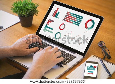 byod concept: laptop and smartphone on a desk workplace. All screen graphics are made up. - stock photo