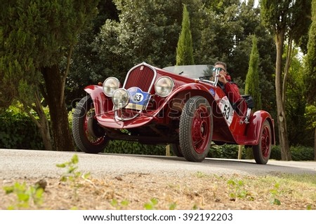 C.BERARDENGO (SI), ITALY - SEPTEMBER 19: A red 1934 Fiat 508 Balilla driven by Vesco - Guerini takes part in the GP Nuvolari classic car race on September 19, 2015 in C.Berardengo. They won the race. - stock photo