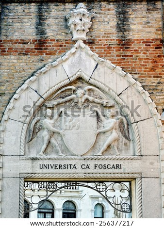 Ca' Foscari University of Venice sign and blazon. Iis a public university in Venice, Italy. Since its foundation in 1868 it has been housed in the Venetian Gothic palace of Ca' Foscari - stock photo