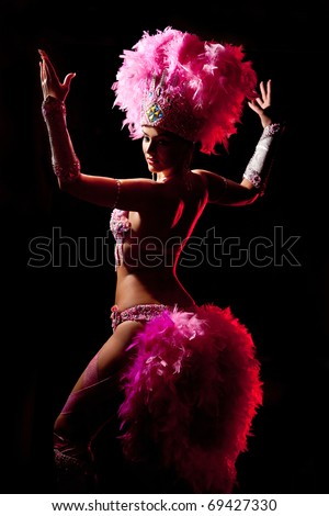 cabaret dancer over dark background - stock photo