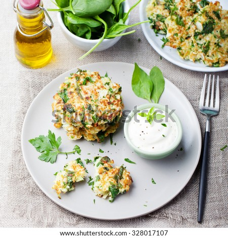 Cabbage and spinach pancakes with yogurt dressing with fresh herbs.  - stock photo