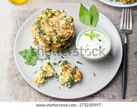 Cabbage and spinach pancakes with yogurt dressing with fresh herbs Top view - stock photo