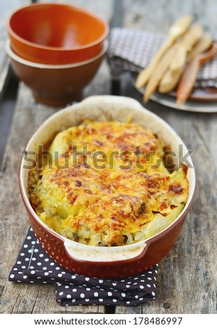 Cabbage gratin on rustic background - stock photo