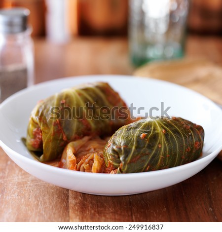 cabbage rolls on plate on top of table - stock photo