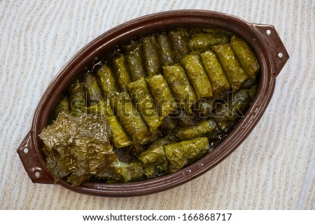 Cabbage Rolls/Tasty vegetarian cabbage rolls. Traditional food on dinning table. - stock photo
